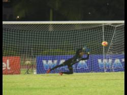 Cornwall College's Peter Sinclair stops a penelty kick in the semi-final of the ISSA Champions Cup against St George's College last year.