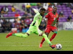 Jamaica's captain and goalkeeper Andre Blake (left)  in action against Suriname during the recent Concacaf Gold Cup.