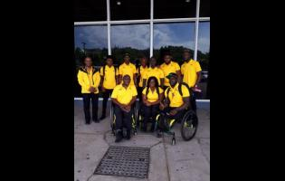 Members of the Para Pan Am delegation (seated from left) Neville Sinclair, sport manager; Santana Campbell; and Navrado Griffiths   (standing from left)  Dr Leroy Harrison, team doctor; Chadwick Campbell, team captain; Jason Brown; Tevaughn Thomas; Jason Ricketts; Theadore Subba; and Shane Hudson ahead of their departure to the games in Lima, Peru.