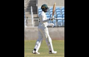 Jamaica Scirpions' Nkrumah Bonner raises hit bat after scoring a century in the CWI Regional Four Day cricket match against the Windward Islands Volcanoes at Sabina Park on January 19.