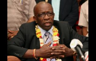 In this June 2, 2011 file photo, suspended FIFA executive Jack Warner gestures during a news conference at the airport in Port-of-Spain, Trinidad and Tobago.