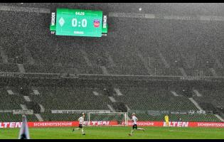 The board shows the result in heavy rain during the German Bundesliga relegation first-leg football match between Werder Bremen and 1. FC Heidenheim in Bremen, Germany, on Thursday, July 2.