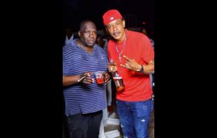 Hennessy Boss (left) and Akex of HD Entertainment chill at the party.