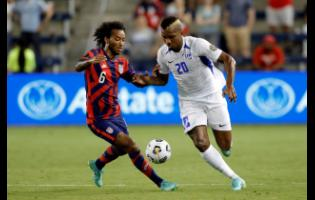 United States midfielder Gianluca Busio (left) battling Martinique's midfielder Stephane Abaul during a Group B Gold Cup match on July 15.