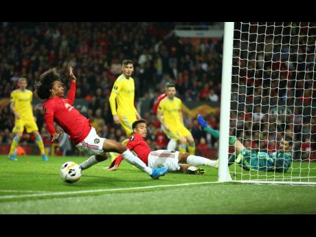Manchester United's Tahith Chong (left) fails to score during the Europa League Group L match between Manchester United and Astana at Old Trafford stadium in Manchester, England, yesterday.