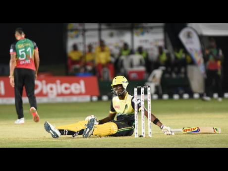 Shamar Springer from the Jamaica Tallawahs was left flat on the ground after a wild swing and miss off the bowling of Rayad Emrit in a Caribbean Premier League at Sabina Park yesterday.