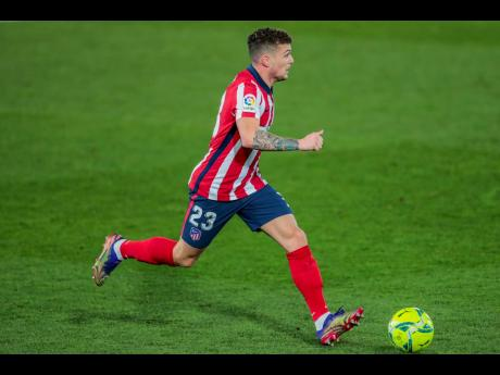 FILE - In this Saturday, December 12, 2020 file photo, Atletico Madrid's Kieran Trippier runs with the ball during the Spanish La Liga soccer match between Real Madrid and Atletico Madrid at the Alfredo Di Stefano stadium in Madrid, Spain.