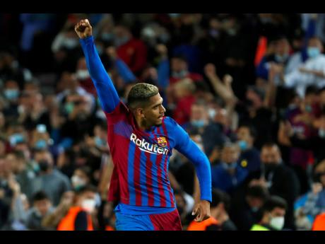Barcelona's Ronald Araujo celebrates after scoring during the Spanish La Liga football match between Barcelona and Granada, at the Camp Nou stadium in Barcelona yesterday.